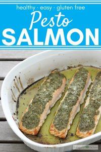 3 salmon fillets covered in pesto in white baking dish