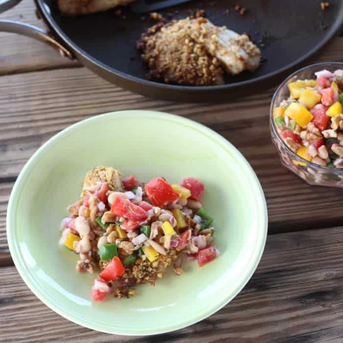 skillet, salsa, and plate with Walnut Crusted Fish with White Bean and Walnut Salsa