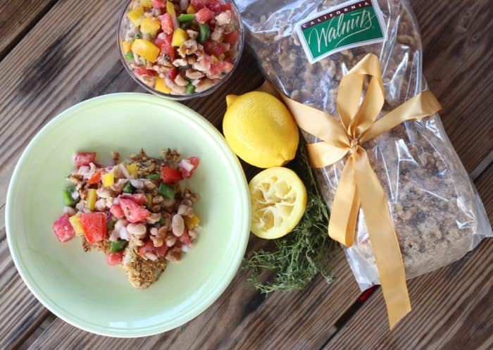 green plate with Walnut Crusted Fish with White Bean and Walnut Salsa, walnuts, lemons, thyme, salsa