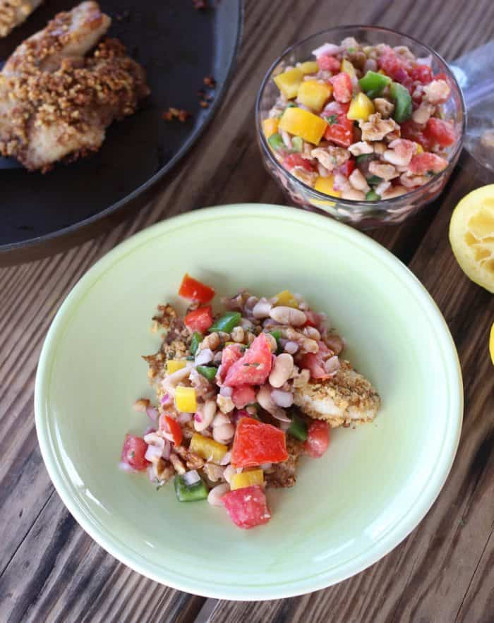 Walnut Crusted Fish in skillet and on plate topped with White Bean and Walnut Salsa and a bowl of salsa