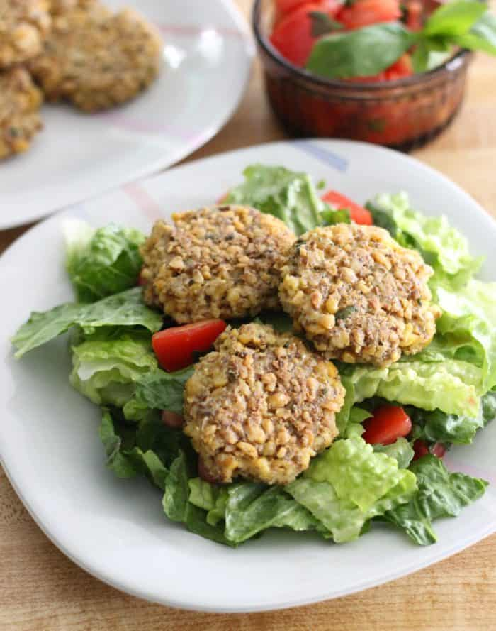 Chickpea Fritters withTomato Basil Salad is a fresh, summery, budget dish. Delicious, vegetarian, gluten-free, and dairy-free, these fritters appeal to justabouteveryone.