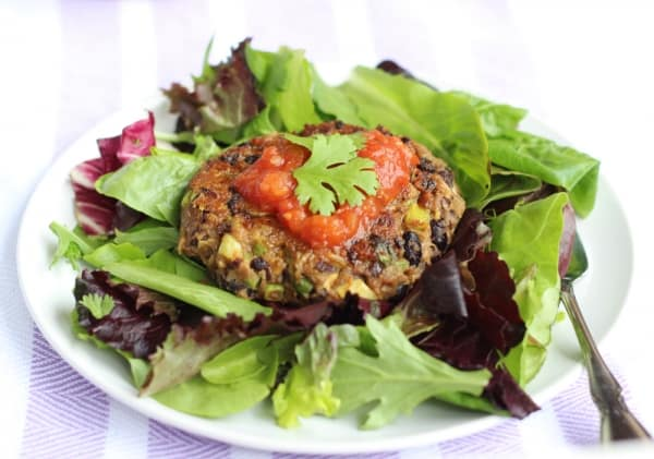 salad greens with avocado black bean burger, salsa and cilantro