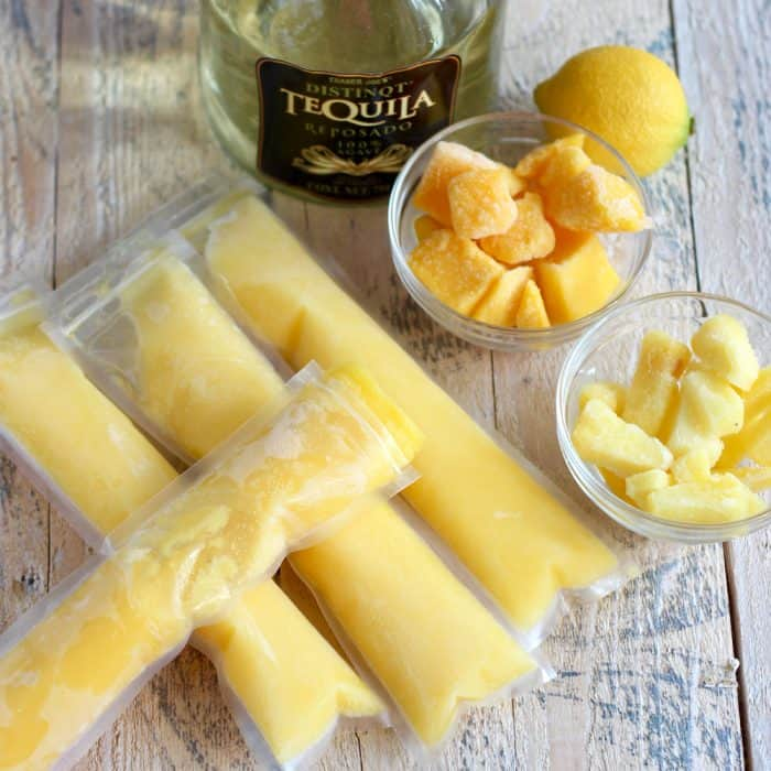 homemade Mango Pineapple Popsicles, tequila, lemon, frozen mango and pineapple
