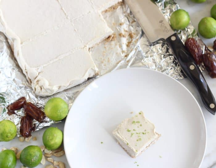 dates, key lime, cashews, Key Lime Pie Bars on foil with bar on plate