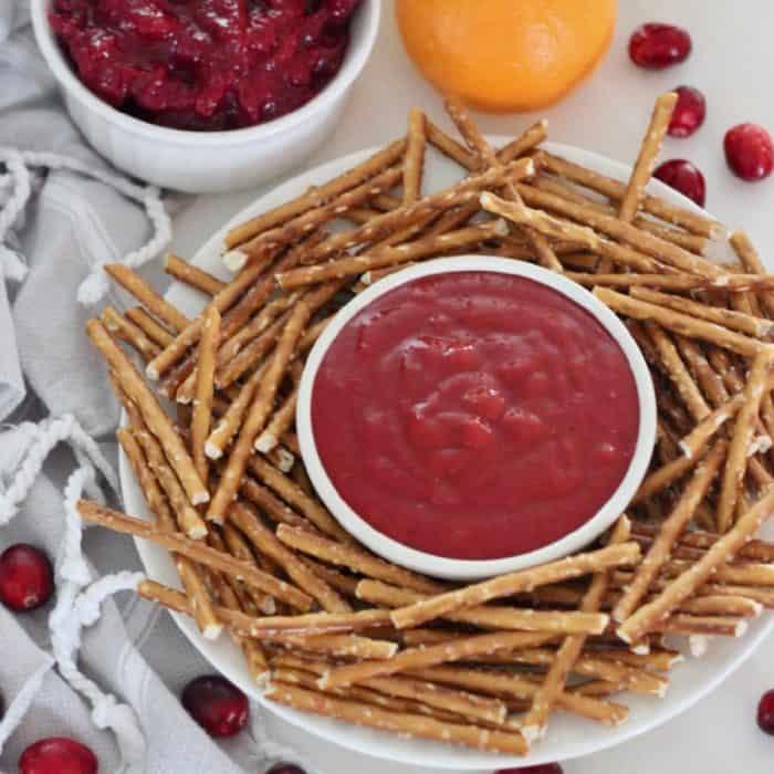 bowl of cranberry honey mustard sauce with pretzels