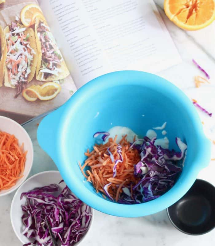 preparation of cabbage and carrot slaw for skirt steak tacos