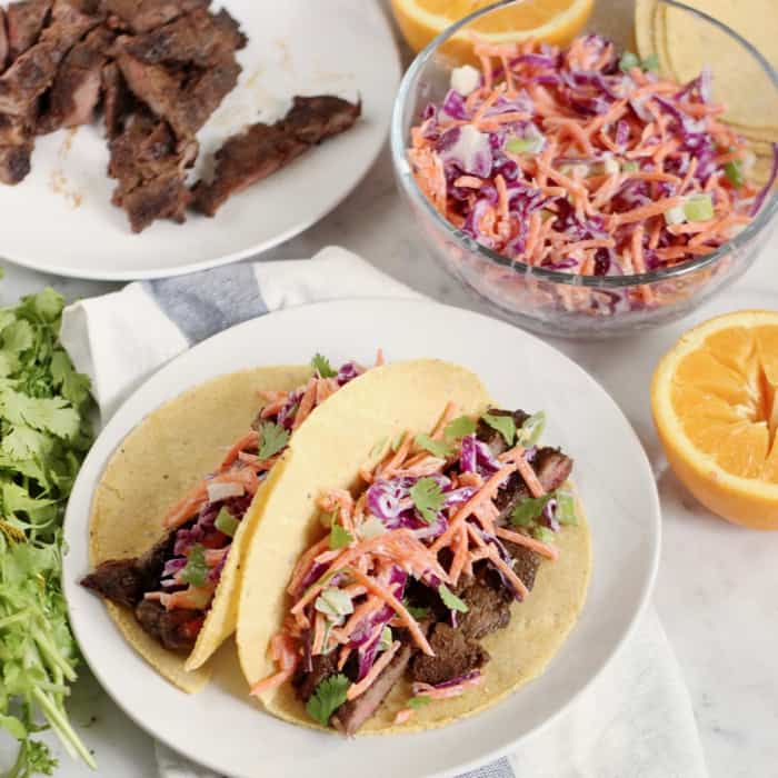 two BBQ Skirt Steak Tacos with slaw and steak