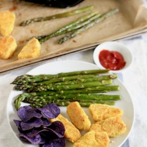 gluten free fish sticks, potato chips, roasted asparagus with baking sheet