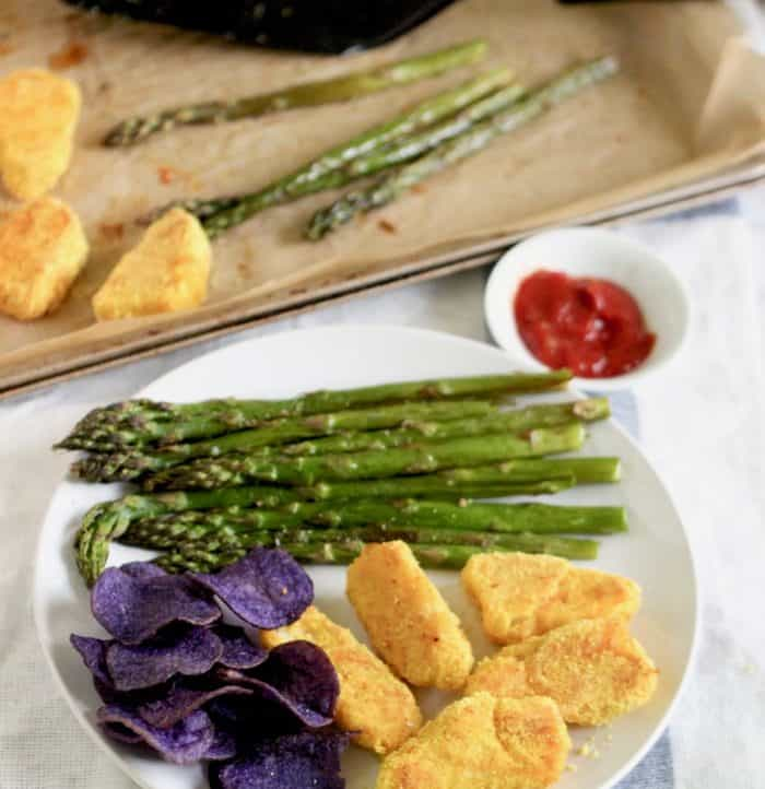 gluten free fish sticks, potato chips, roasted asparagus with baking sheet