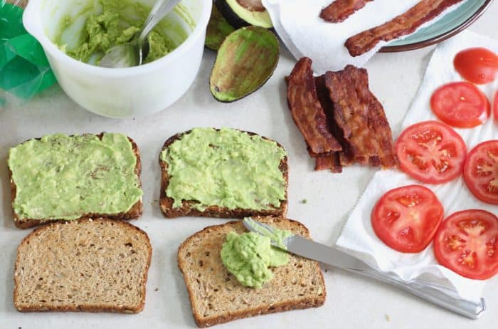 bread with mashed avocado for a BLT