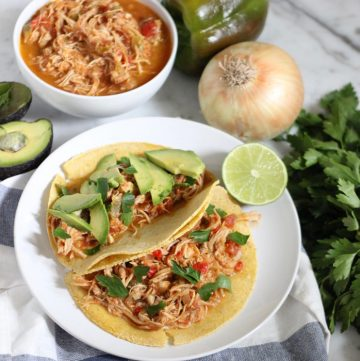 salsa chicken in tortillas with avocados and parsley