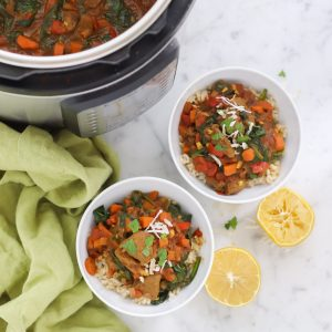 instant pot with lamb curry and two bowls of curry