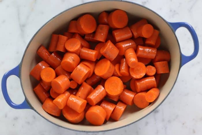 pot of carrots tossed in oil