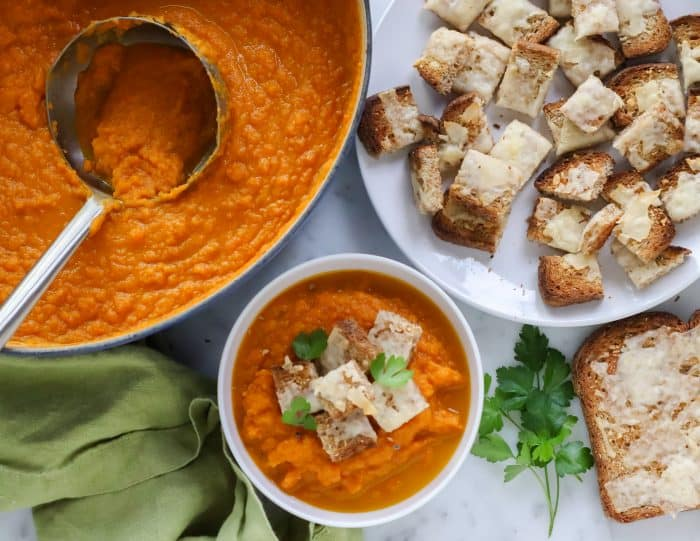 bowl of roasted carrot soup with parmesan croutons