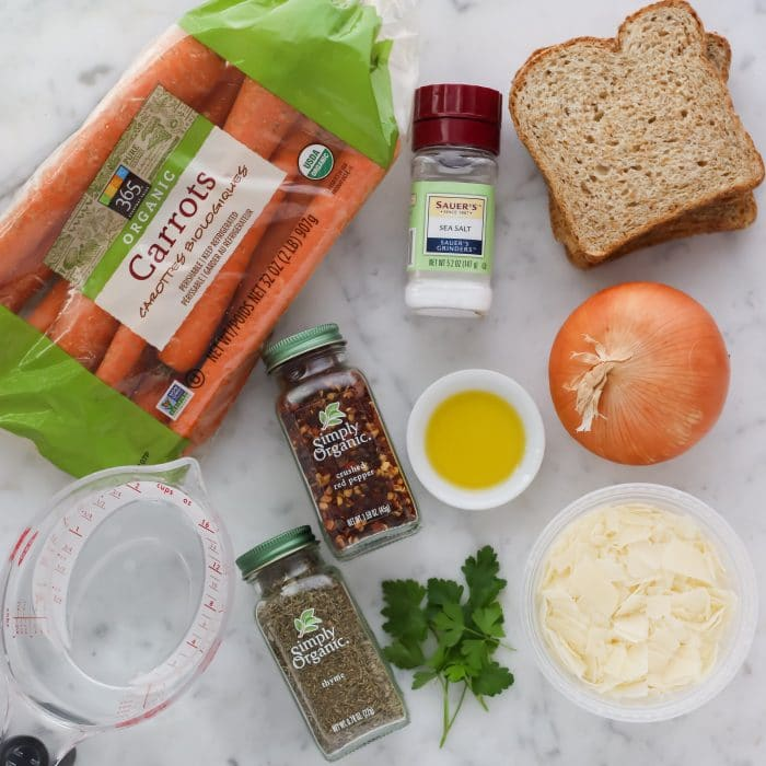 ingredients to make carrot soup: carrots, water, spices, oil, onion, bread, and parmesan