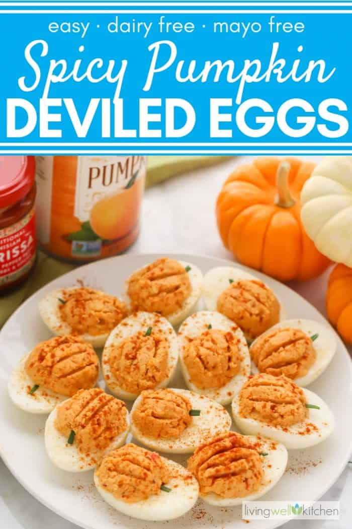 plate of pumpkin deviled eggs with mini pumpkins