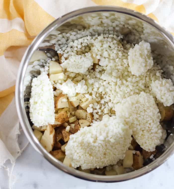 potatoes, cauliflower, salt, pepper in the instant pot