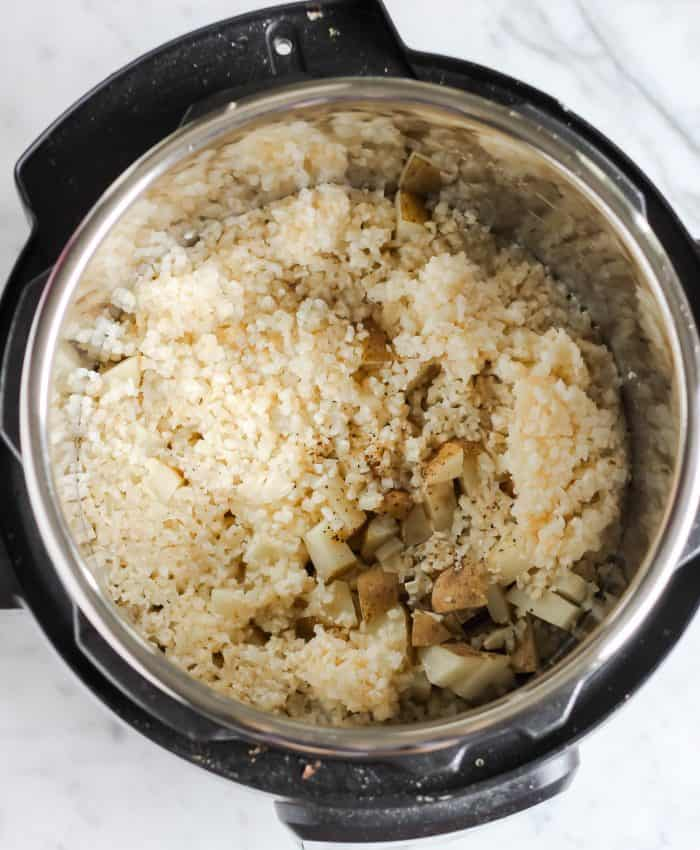 cooked potatoes, cauliflower, salt, and pepper in the instant pot