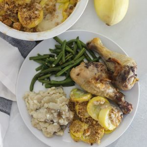 plate of squash casserole, mashed potatoes, green beans, and chicken