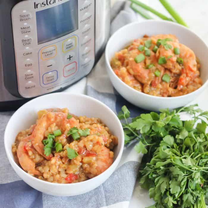 bowls of jambalaya with parsley and instant pot