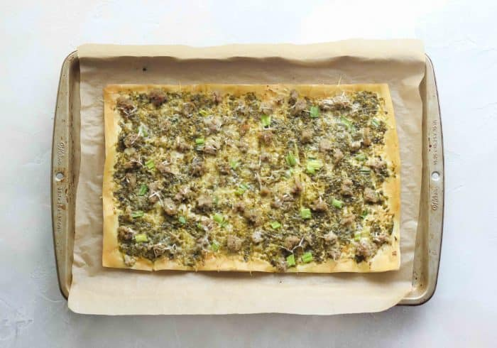 phyllo dough baked with pesto, meatballs, cheese, green onions