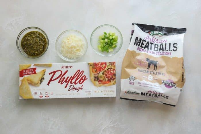 phyllo dough, frozen meatballs, pesto, parmesan cheese, green onions
