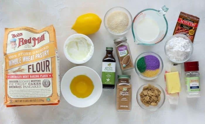 pastry flour, lemon, yogurt, egg yolk, sugar, vanilla extract, cinnamon, nutmeg, milk, colored sugar, brown sugar, butter, salt, powdered sugar, yeast