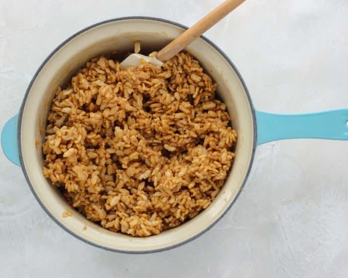 rice crispy treat mix in blue saucepan