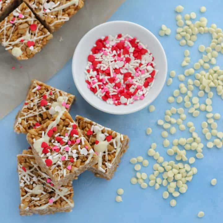 rice crispy treats with white chocolate drizzle, white chocolate chips, and sprinkles
