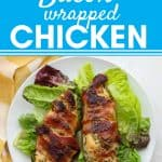 lettuce with bacon wrapped chicken on white plate and yellow striped napkin