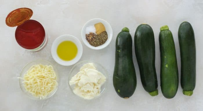 tomato sauce, mozzarella, ricotta, olive oil, spices, zucchini to make zucchini lasagna