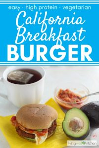 burger on yellow napkin with salsa, avocado, egg, tea