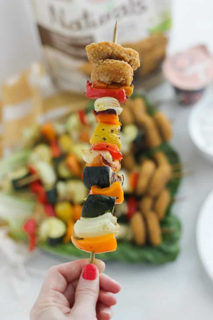 vegetable kabob with chicken nuggets and a plate of kabobs