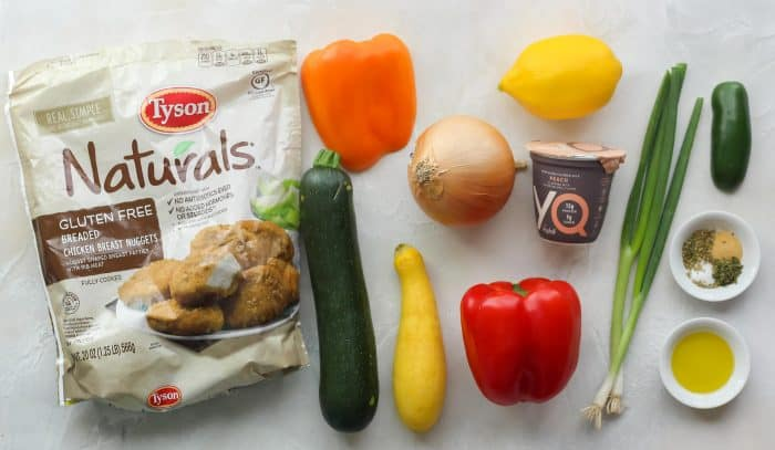 frozen chicken nuggets, orange bell pepper, zucchini, yellow squash, onion, red bell pepper, lemon, peach yogurt, green onions, spices, jalapeño, spices, olive oil