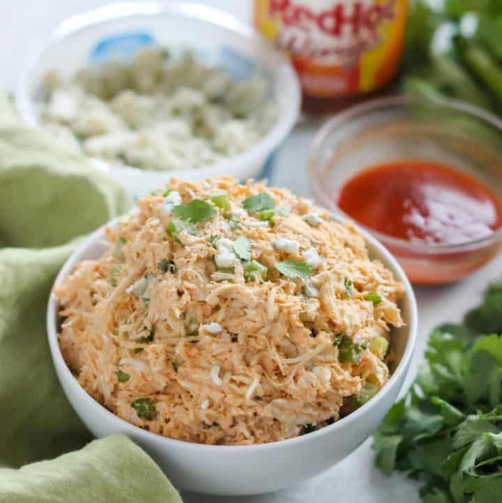 bowl of Buffalo Chicken Salad, blue cheese, wing sauce, celery, cilantro