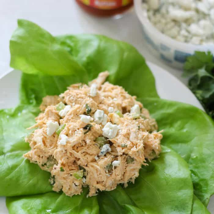 lettuce leaves topped with Buffalo Chicken Salad and blue cheese
