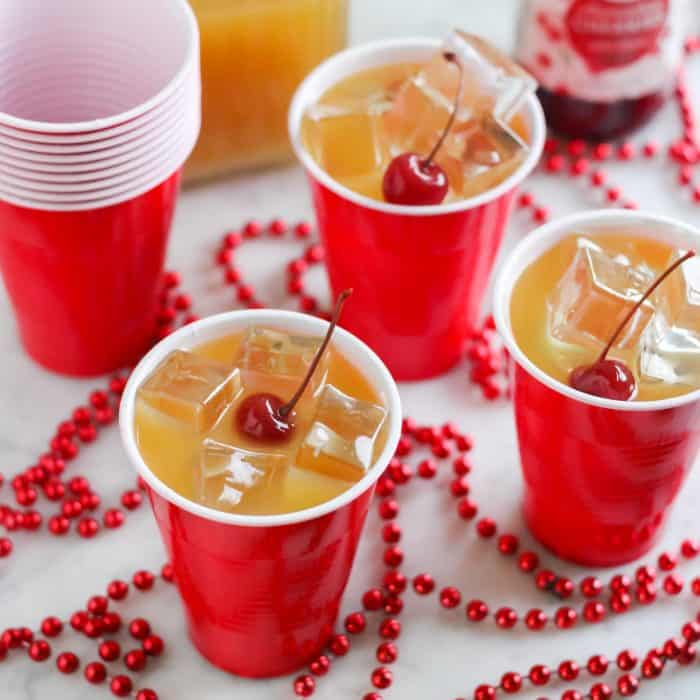 yellowhammer drinks in red cups with cherries on top