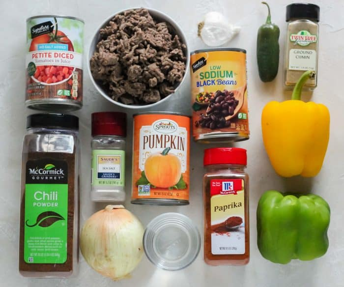 diced tomatoes, chili powder, ground beef, salt, onion, water, pumpkin puree, garlic, black beans, paprika, green bell pepper, yellow bell pepper, cumin, jalapeño
