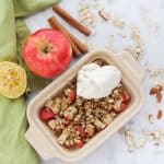 baked apples in microwave with ice cream on top, green napkin, raw oats, cinnamon sticks, apple, lemon
