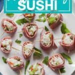 beef sushi on a white plate with text overlay that says fun, gluten free, make ahead muffuletta beef sushi